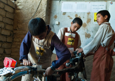 Young boys, mostly orphans, train to become mechanics in a center run by the German NGO HELP.