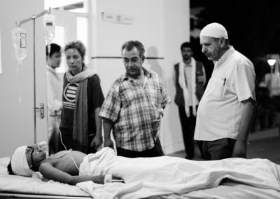 Surgeons, Danilo Ghirelli and Farman Hasan stand over a child whom they are unable to save.