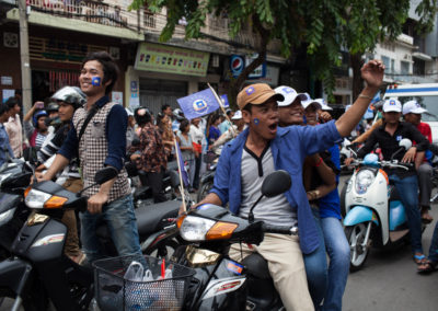 CNRP supporters drive the streets ahead of Sam Rainsy's motorcade on the day he arrived at the airport after years of exile.