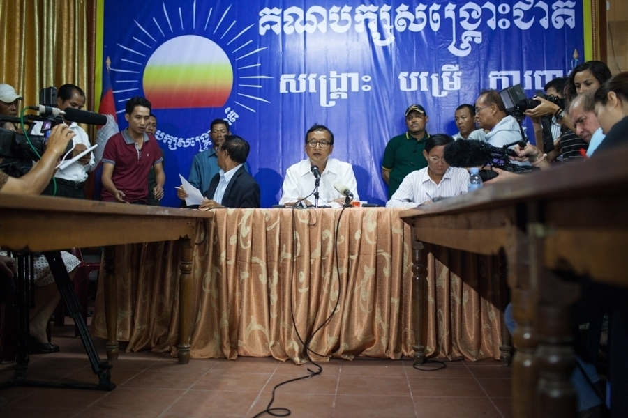 Sam Rainsy gives a press conference just hours before the NEC declares official results, with the ruling CPP victorious.