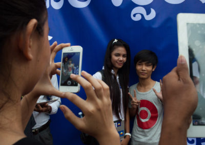 Social media star Sovantha Ty (L), founder of the opposition Facebook page I Love Cambodia Hot News poses for a photo at a massive rally for opposition leaders Kem Sokha and Sam Rainsy.