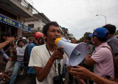 A crowd of CNRP opposition party supporters heckle a ruling CPP party political commentator they spotted walking down the street during the first of three days of mass protests against the election results.