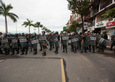 Police standoff with supporters of the opposition party CNRP, who are protesting road blocks installed along riverside during the first of three days of mass protests against the election results.
