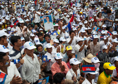 A large crowd of supporters gathers to welcome back opposition party leader Sam Rainsy.