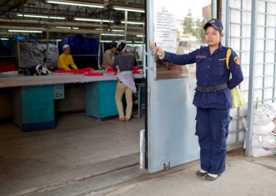 A guard opens the door to the ironing section of a garment factory on the outskirts of Phnom Penh.