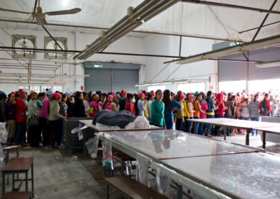 Laborers go on lunch break at a garment factory on the outskirts of Phnom Penh.