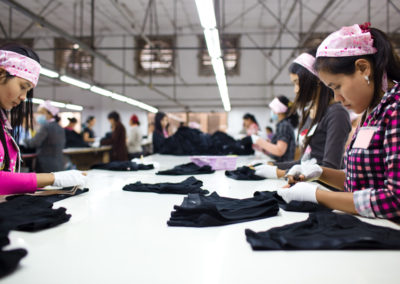 Laborers fold clothing ready for packing at a garment factory on the outskirts of Phnom Penh.