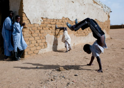 Young Sudanese refugees show off their acrobatic skills at Camp Iridimi.