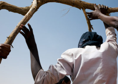 Darfuri Refugees working for local NGO Adesk deposit dead wood to be used as cooking fuel for the Sudanese refugees.