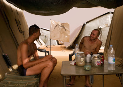 Soldiers have a coffee during afternoon relaxtion hours.