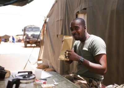 A soldier smells a letter sent by his wife.