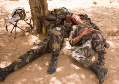 Soldiers take a nap in the afternoon sun during exercises in Biltine valley.