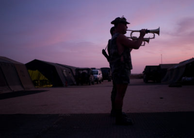 Soldiers play the trumpet every morning to rise the troops.