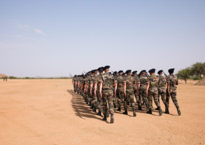 Soldiers of the 7th Battallion de Chasseurs Alpins march in tandem during July 14 celebrations.