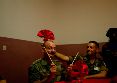 Commander Eric Gentieu celebrates his birthday with Colonel Vincent Floret at a Chinese restaurant in Iriba.