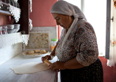 Fazile Yilmaz makes flat bread in her kitchen.