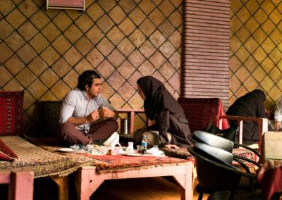 A couple enjoys lunch in the bazaar of Tehran.