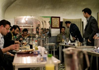 Men enjoy lunch at a kebab shop inside the bazaar of Tabriz.