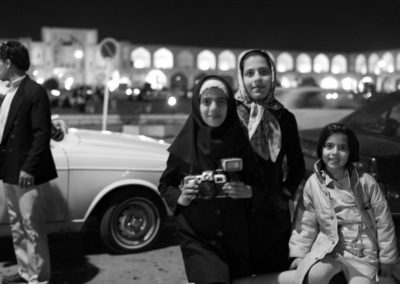 A young photographer enjoys an evening at Imam Square in Esfahan.