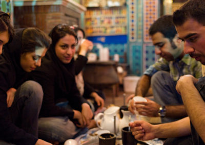 Young architecture students eat together at a traditional restaurant in Isfahan.