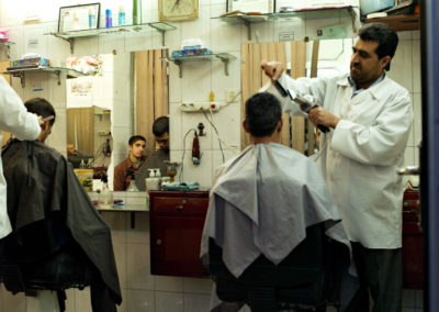 Men get their hair cut at a barber shop in downtown Yazd.