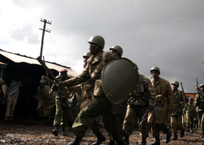 Police charge into a residential neighborhood of Kibera slum during outlawed protests that resulted in 15 gunshot wounds, and three deaths.