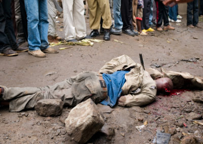 A man suspected of being a Mungiki informant was stoned and beaten to death in the Nairobi slum of Mathare North.