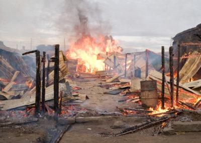 Kikuyu houses burn in the Idima slum of Naukuru.