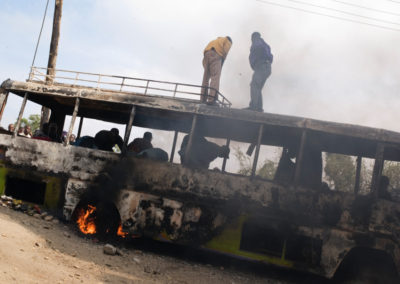 Demonstrators take apart a bus they burned in Mathare North slum, Nairobi.