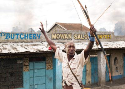 Nakuru, Kenya. A Kalenjin man brandishes his bow and arrow during street clashes.
