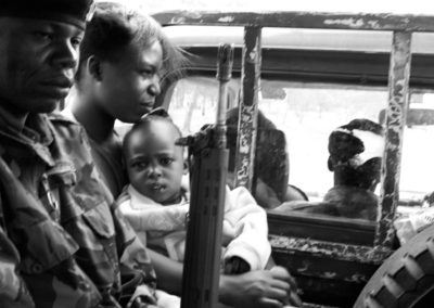 A Luo woman and her child are brought to safety by security forces during an outbreak of violence in Naivasha, when rivalling ethnicities purged the community in a bid to reclaim ancestral lands.