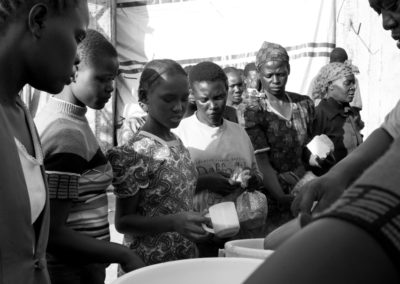 Newly arrived IDP's stand in line for food at a makeshift IDP camp in Kisumu.