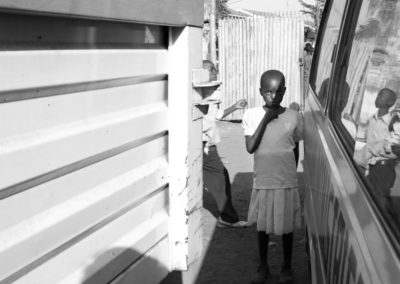 A young girl in a makeshift IDP camp in Kisumu after being chased from her home in the Rift Valley.