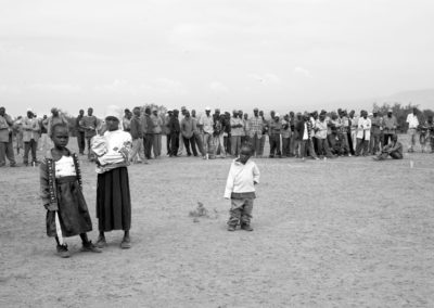 Internally displaced Kikuyus stand at the main entrance of the Naivasha camp waiting to be employed by the Kenya Red Cross.