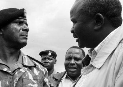 A military commander talks with local politicians about the security situation in the Rift Valley town of Chepilat.
