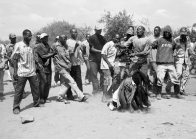 An angry mob attacks a Kikuyu man they accuse of being a member of the Mungiki sect in Mathare North slum, Nairobi.