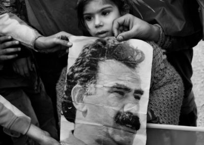 "Boys display a photo of imprisoned PKK leader Abdullah ""Apo"" Ocalan during celebrations in Istanbul for the Kurdish New Year, Newroz."