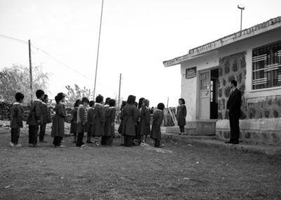 A young Kurdish girl leads the nationalist recitation before morning classes in Bozkuyu.