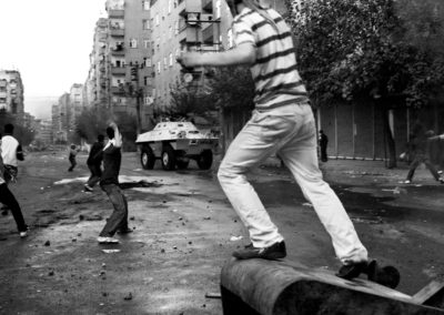 Protesters throw stones at a tank in a Kurdish residential area of Diyarbakir.