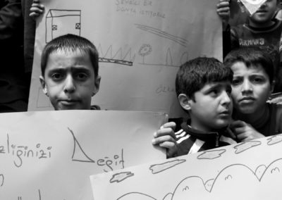 Children gather with their families and a human rights organization to protest the detention of minors for participating in street protests.